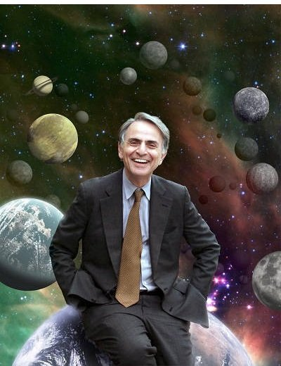Photograph of Carl Sagan in front of a backdrop showing numerous planets. Sagan appears to be sitting on the planet Earth.