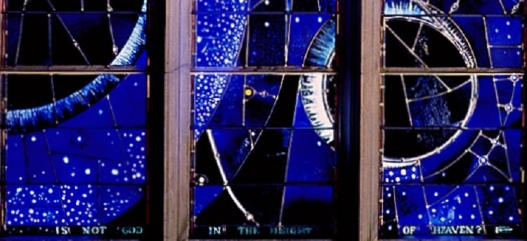 The 'Space Window' at Washington National Cathedral. Stained glass window, with text: 'Is not God in the height of heaven?'.
