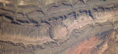 Photograph of the Ouarkziz Impact Crater in Algeria, which was formed by a meteor impact less than 70 million years ago.