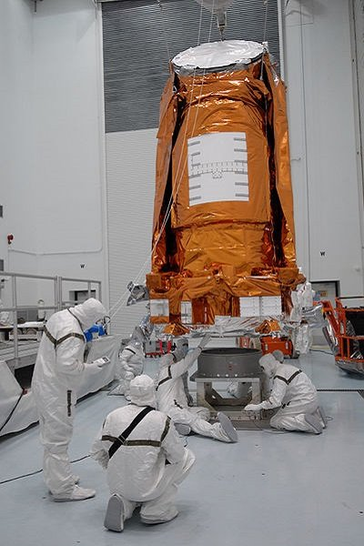 A photograph of scientists working on the Kepler spacecraft.