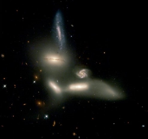 Photograph of six galaxies.