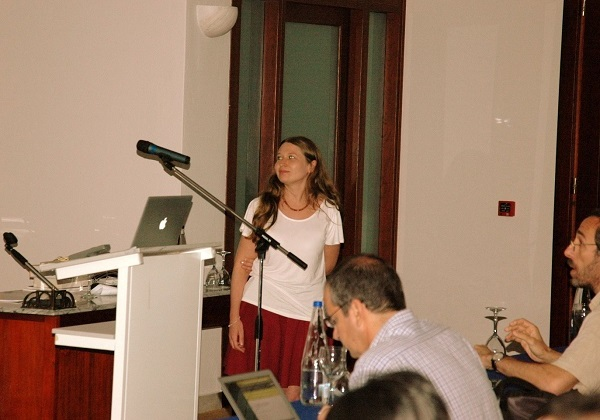Photograph of Dr Helen Klus at the Half a Century of X-ray Astronomy conference in Mykonos, Greece.