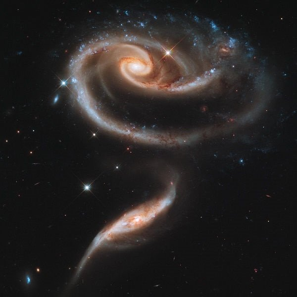 Photograph showing two interacting galaxies.