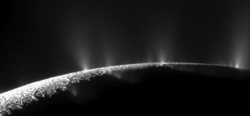 Photograph showing plumes of water on Enceladus.