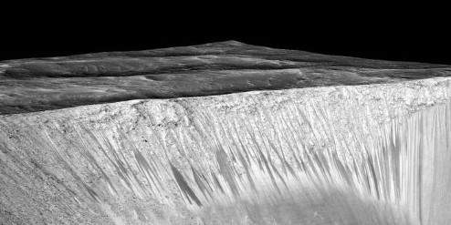 Dark streaks on the inside of a Crater on Mars.